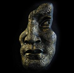 This is about the third version of an original face that I carved based on Michelangelo's David.