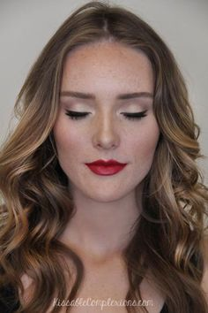 A timeless red pout with barely-there foundation and a subtle cat-eye is a classic holiday look. #cateye #red #lipstick