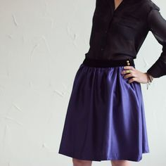 The prettiest of skirts with a luxurious, black velvet waistband paired with a sheer black blouse.