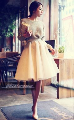 Full skirt, soft look. Love the smooth ruffles of the skirt with the bunchiness of the sweater.