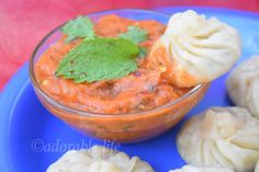 momos( chicken stuffed dumplings) with spicy red chilly dip