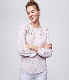 45a739bc06bbaa Ruffled shoulders lend an artful allure to this feminine top Trendy Tops