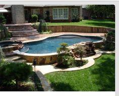 A Hillside Back Yard Including A Swimming Pool Multilevel Decks