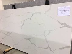 Calcutta Gold Quartz. This stone features a clean white color with a bold veining. This countertop offers the look of luxurious marble without the maintenance. Stop into our Burton or Midland showroom to see for yourself how gorgeous this quartz truly is!!! http://www.stonespecialists.net/