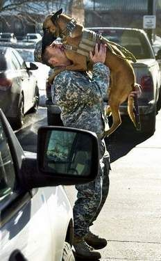 Kiss, kiss. Ttaryn, a 4-year-old Belgian malinois, leaps into the arms of her trainer, Sgt. Rodolfo Martinez.