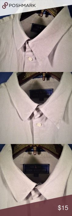 """John Ashford Solid Tan Button Down Dress Shirt Thank You for choosing Kross Threads! Condition: Excellent Pre-Owned Condition. While we strive for perfection, If any flaws are found please contact us for a solution.Label: John Ashford Material: 100% cotton Color: Solid Tan Size: Large Country: sri lanka Measurements Pit to Pit (Across Chest): 22.5"""" Sleeves (Top of Shoulder to Cuff): 22"""" Length   (Top of Collar to Hem): 30"""" Our mission is to provide unique quality style to your wardrobe John…"""