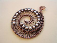Nautilus Pendant---Copper Wire/Sterling Beads. $38.00, via Etsy.