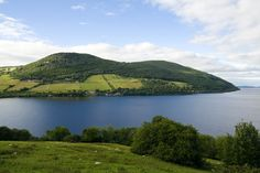 Scotlands most famous lake Loch Ness in summer time near town Drumnadrochit. Scotland Travel, Scotland Uk, Loch Ness Scotland, Cairngorms National Park, Famous Landmarks, Outlander, Trip Planning, Places Ive Been, Ireland