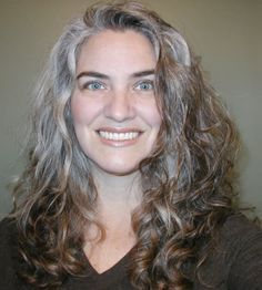 Gray and brown curly hair - love the way the silver plays up her eyes.