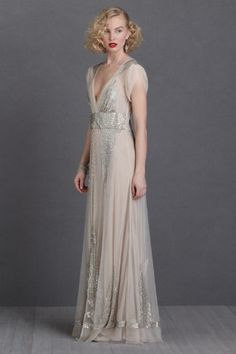 1920s inspired wedding dress, the Aiguille by BHLDN and Anna Sui. Arcs of sequins and a row of round buttons adorn a straight and clean 1920s inspired silh - 1920s Wedding Dress|| Aiguille || BHLDN