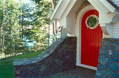 Custom porthole door by TEA2 Architects - Bayfield Carriage House