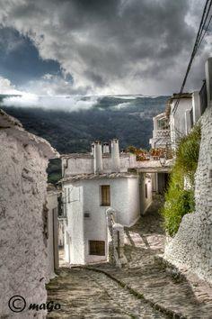 'Capileira' es un pequeno pueblo de Sierra Navada (Granada) esta a 1500 my. de altura, los techos son planos y una chimeneas tipicas. photo by Manuel Gonzalez via photo.net
