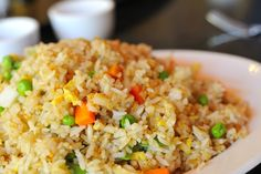 Recipe including course(s): Entrée; and ingredients: baby carrot, egg, green peas, sesame oil, soy sauce, vegetable oil, water, white rice