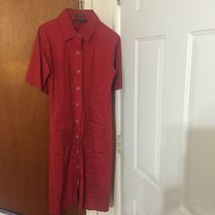 A button down dress. A button down Anne Klein dress with stretch and 2 front pockets. Anne Klein Dresses