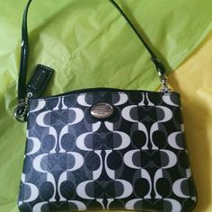 Coach wristlet This is brand new without tags  Its made of a heavy canvas material.  It has 2 slots on the inside, for storing cards. This inside is black, my camera on phone, doesn't take good pictures of black. Its 6 inches wide and. 4 inches tall. I never used it Its in Mint condition Coach Bags Clutches & Wristlets
