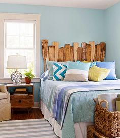 Airy Blue Nautical Bedroom Suite with an eye catching oar headboard: http://www.completely-coastal.com/2014/10/blue-nautical-bedroom-suite.html