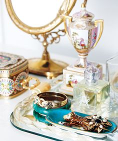A tin tea box, mirrored tray and even vintage jewellery count as art.