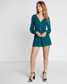 The romper is reimagined with an exposed metal front zipper and the sweet softness of sheer sleeves. Go for an all-out leggy look with gladiator sandals.