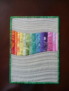 Simple idea for a small wall quilt for home decor.  Colors of course to coordinate