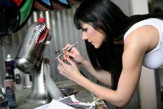 Nicole Dinardo airbrushes warbird-themed Kitchenaid mixer.