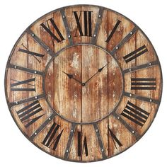Wood-inspired wall clock with a distressed face and Roman numerals.    Product: ClockConstruction Material: Met...