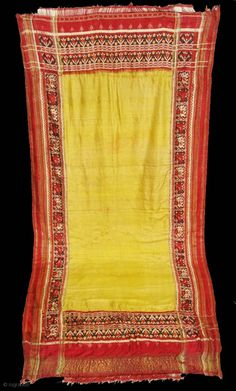 A silk double ikat patola sari, probably from Patan, Gujarat, India. This patola uses one of the more rare designs known as Panetar