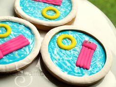 I made these pool party cookies as part of a collaboration with the talented Laura of Krazy Kool Cakes. She makes the cutest fondant cupcake toppers! Visit her YouTube channel to see her tutorial on how to make a fondant swimming pool cupcake topper