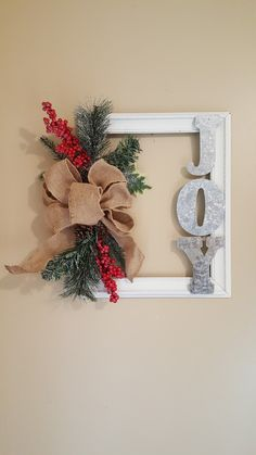 Check out these awesome last minute DIY Christmas decorations on a budget that will brighten your home over the festive season. Picture frame wreaths are really cheap and easy holiday decor ideas that you can use for your indoor or outdoor decorations Christmas Wood, Diy Christmas Ornaments, Homemade Christmas, Diy Christmas Gifts, Simple Christmas, Christmas Holidays, Diy Christmas Frames, Cheap Christmas Crafts, Christmas Ideas