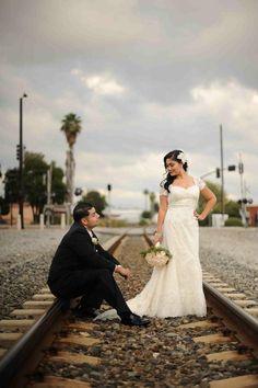 Lorraine and Erik posed for a cute wedding portrait on the local train tracks. Photography: Hazelnut Photography. Read More: http://www.insideweddings.com/weddings/european-influenced-autumn-wedding-in-los-angeles-california/365/