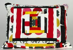 Sheri Schumacher - modern and vintage fabric handmade pillows - $175. The Museum Store is a handcrafted gallery style space representing local and regional artists.