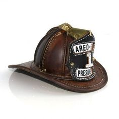 The fire helmet may be all that stands between escape and death for a firefighter. Fire Dept, Fire Department, Womens Motorcycle Helmets, Motorcycle Girls, Fireman Hat, Firefighter Emt, Fire Helmet, Fire Equipment, Fire Engine
