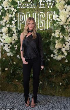 Bouncing back! Rosie Huntington-Whiteley is already back in her skinny jeans just two months after giving birth for the launch of her new fashion collection with Paige