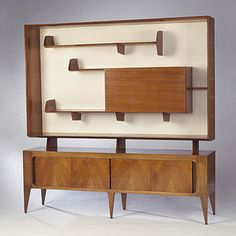 "Gio Ponti's mid century modern ""Display cabinet"" manufactured by Singer and Sons."