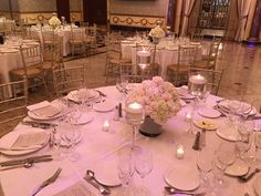 all white wedding low centerpiece with floating candles
