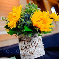 Not crazy about the colors, but I really like the birch bark vase with the initials carved into it.