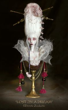 http://www.etsy.com/listing/96968024/lost-in-a-dream-art-doll-bust