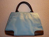 Bolso azul de mano