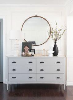 dresser decor Grey dresser, round mirror, vase with greenery, tabletop styling Studio McGee Bedroom Dresser Styling, Bedroom Dressers, Bedroom Furniture, Dresser Top Decor, Home Interior, Interior Design, Scandinavian Interior, Grey Dresser, Dresser Mirror