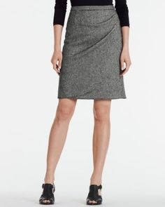 A new addition for your work-to-weekend wardrobe, our gathered skirt features a playful (and camouflaging!) faux wrap, darts for shaping, and an exposed metal zipper in back. In a lovely light tweed that will be a fast favorite paired with leggings and booties, or tights and tall boots. Classic fitAbove-knee lengthWool/viscose/poly/spandexStretch-poly liningImported