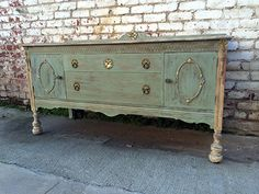 We found a buffet at a salvage yard and turned it into a beautiful TV stand with Chalk Paint®, decorative paint by Annie Sloan.  A wash of Old Ochre and Coco on the top and Duck Egg Blue on the body.  We distressed and applied Annie Sloan Soft Clear Wax then Dark Wax.  To add a little bling, we added some Gold Gilding.   #chalkpaint #anniesloan #duckeggblue #anniesloanunfolded #bathandmore