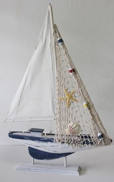 California Seashell Company Retail - Nautical Sailboat, $17.99 (http://www.caseashells.com/nautical-sailboat/)