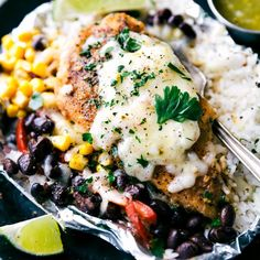 Creamy salsa verde chicken with rice and veggies all cooked at once in a foil packet! No need to pre-cook the rice, chicken, or veggies!