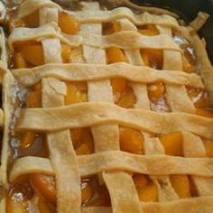 Flaky pastry enclosing peaches flavored with lemon and orange juice and spiced with nutmeg and cinnamon.