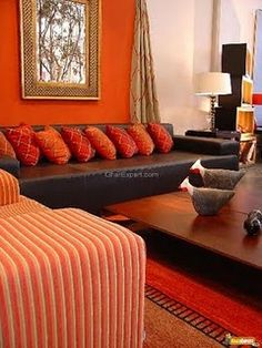 ELECTRIC ORANGE PLAYS VERY WELL WITH BLACK SOFA STRIPS SINGLE SITTER SOFA..