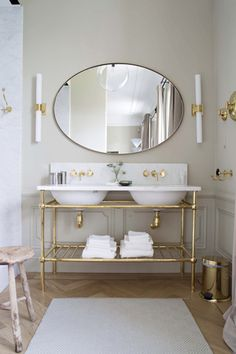 Architectural Digest - bathrooms - gray bathroom, gold and gray bathroom, oval mirror, large oval mirror, long sconce, long brass sconce, br...