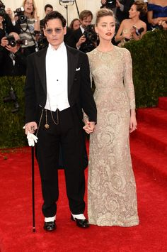 Pin for Later: Who Wore What: See Every Look on the Met Gala Red Carpet Johnny Depp and Amber Heard at the 2014 Met Gala Quite the handsome pair! Johnny Depp joined Amber Heard, who accessorized her long-sleeved gown with 19th Century Fred Leighton diamonds.