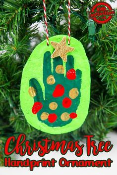 Turn your child's handprint into a Christmas tree with this adorable homemade holiday ornament idea.