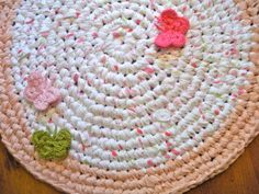 How to Make an Upcycled Crochet Rug. I am sooo doing this. Gotta find a giant crochet hook.