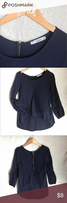VOUS ENVIE navy quarter length high-low shirt This VOUS ENVIE navy shirt has been worn 2 times. gold zipper in the back. quarter length sleeves. high-low top. in great condition. a great staple for any wardrobe. make an offer! Vous Envie Tops Blouses