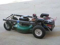 Radio Controlled / Robotic lawnmower. Crazy, but very cool.  Arduino-RC-Lawnmower-painted[1]
